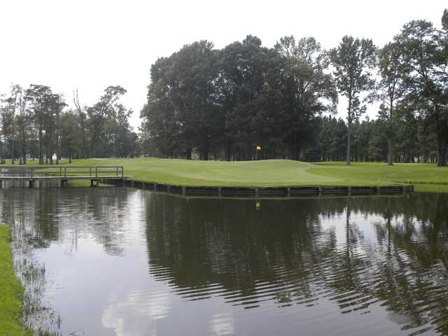 A view over the water of a green at Baywood Golf Club