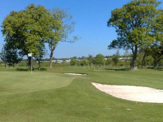 A view of a hole protected by bunkers at Percy Wood Golf & Country Retreat