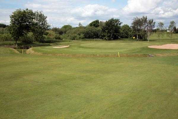 A view of green #14 flanked by bunkers at Heysham Golf Club