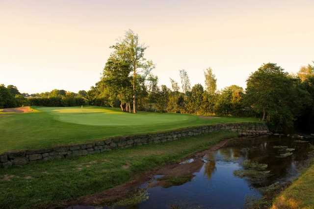 A view over the water of a hole at Dundrum Golf Course Tipperary
