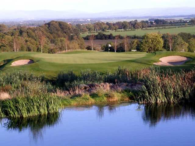 A view over the water of a hole at Dunmurry Springs Golf Club