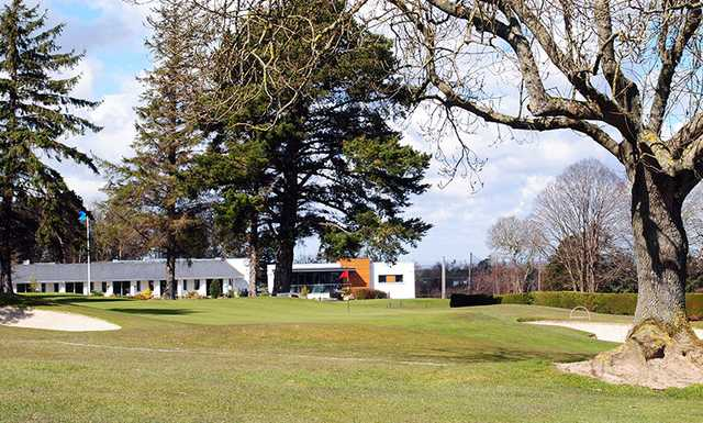 A view of the 9th green flanked by bunkers at Edmondstown Golf Club