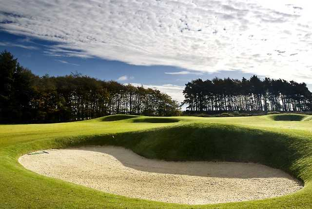 A view of the 3rd hole protected by undulating bunkers at Rowallan Castle Golf Club