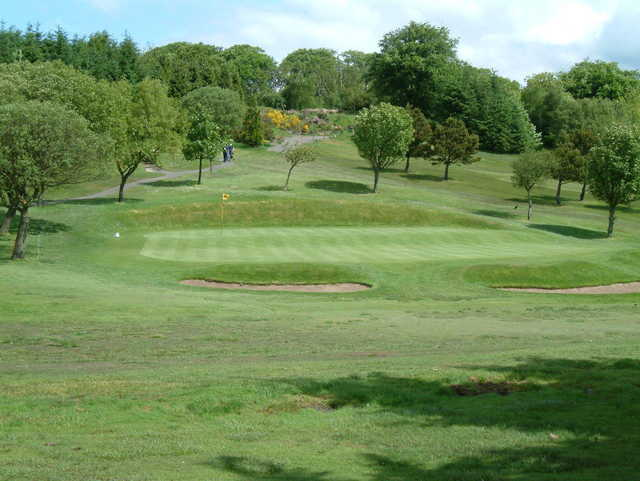 A view of the 2nd hole with a narrow path on the left side at Windyhill Golf Club