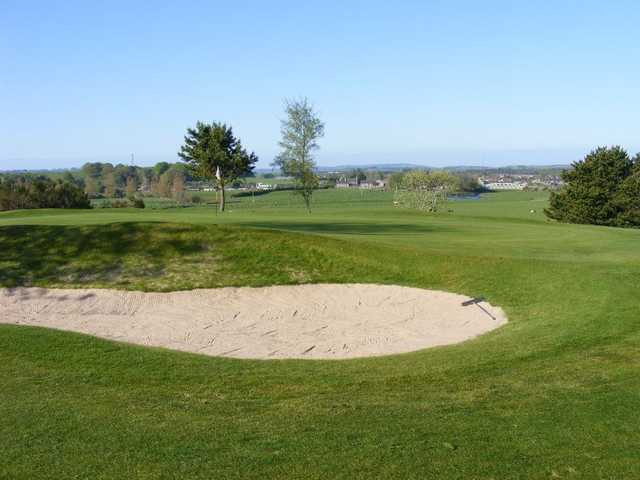 A view of the 1st hole guarded by bunker at Kintore Golf Club