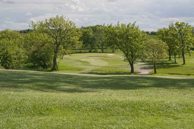 A view of a green guarded by a collection of tricky sand bunkers at Clydebank and District Golf Club