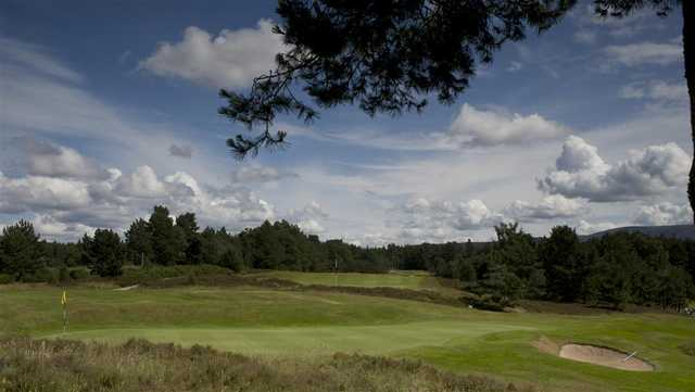 A view of a green protected by a bunker at Grantown-on-Spey Golf Club