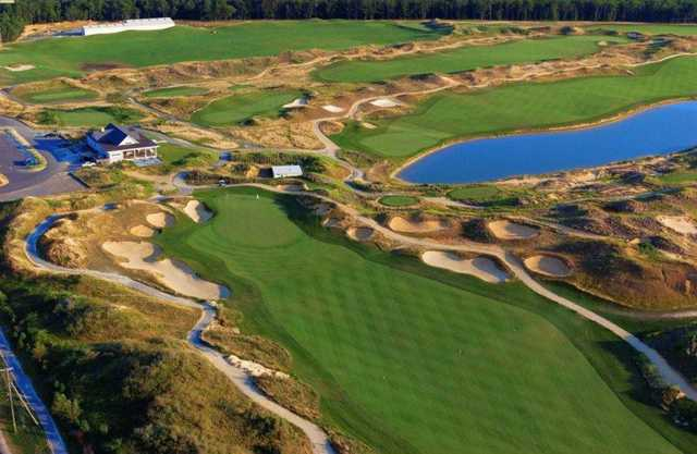Aerial view of the fun green #18 and the clubhouse at Twisted Dune Golf Club