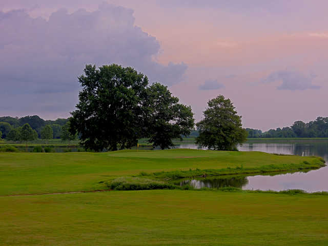 A view of the par 3 hole #11 surrounded by water at Orgill Golf Course