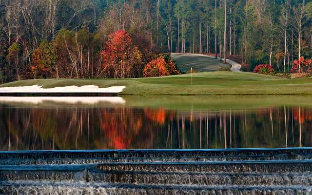 A fall view over the water of the 11th hole at Falls Course from Magnolia Grove Golf Club