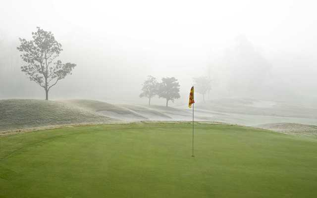 A view of green #10 surrounded by fog at Falls Course from Magnolia Grove Golf Club