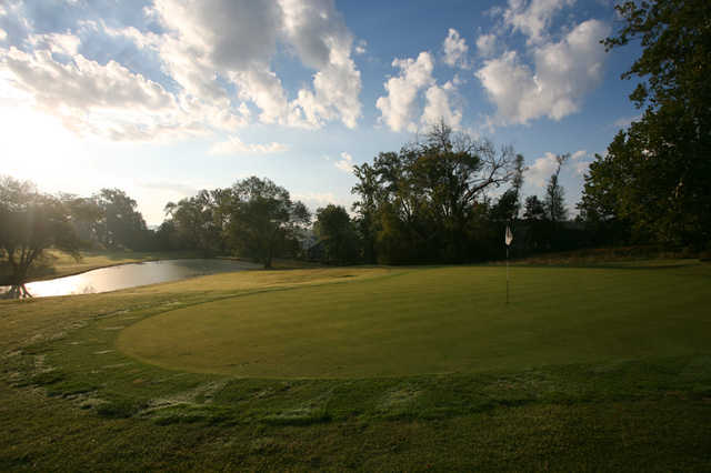A view of hole #6 with water in background at Oak Meadow Country Club