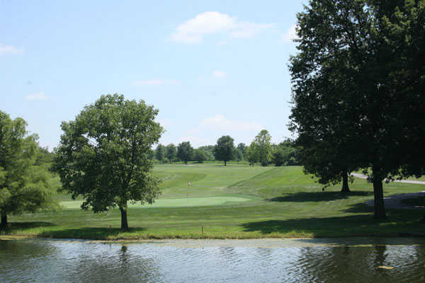 A view over the water of a green at Heritage Park Golf Course