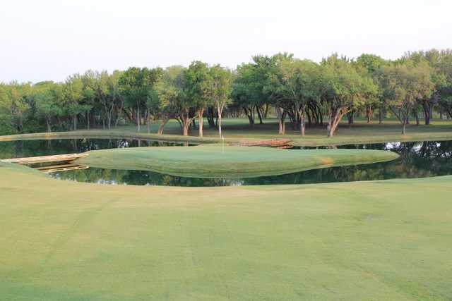 A view of a green surrounded by water at SugarTree Golf Club
