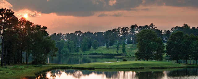 A view of the 15th green surrounded by water at Lakes from Grand National Golf Course