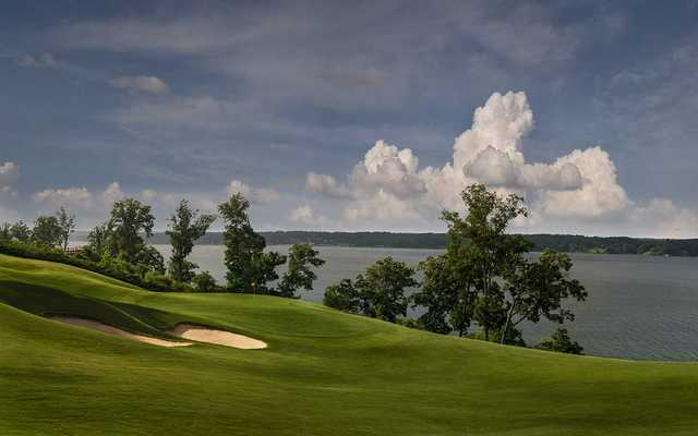 A view of the 18th hole with water in background at Fighting Joe Course from Shoals Golf Club
