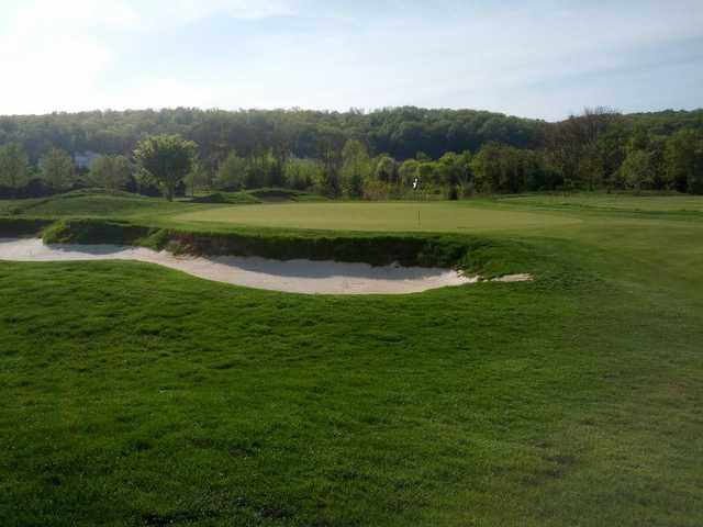 A view of a green protected by an undulating bunker at Raspberry Falls Golf & Hunt Club (Tyler Dunmyer)