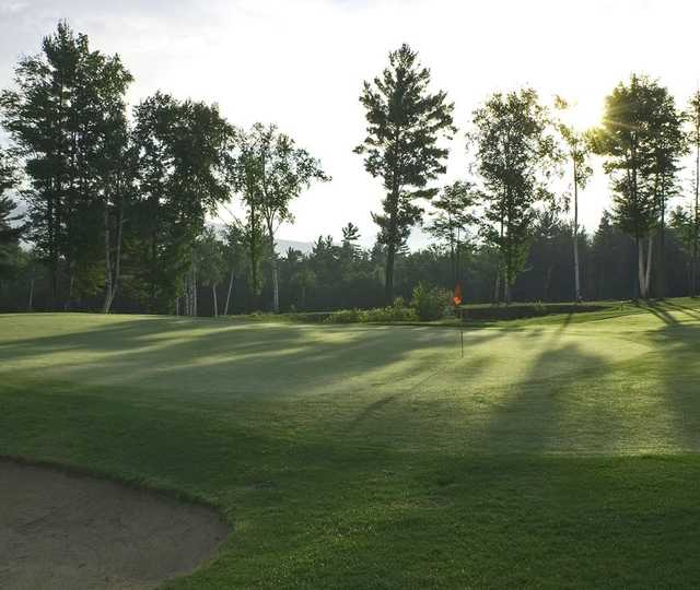 A sunny day view of a green at Owl's Nest Golf Club