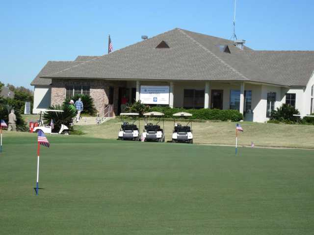 A view of the clubhouse and the practice area at Beaver Creek Golf Course