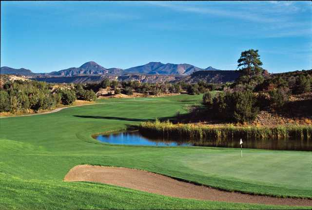 A view of green #18 with mountains in background at Cochiti Golf Club
