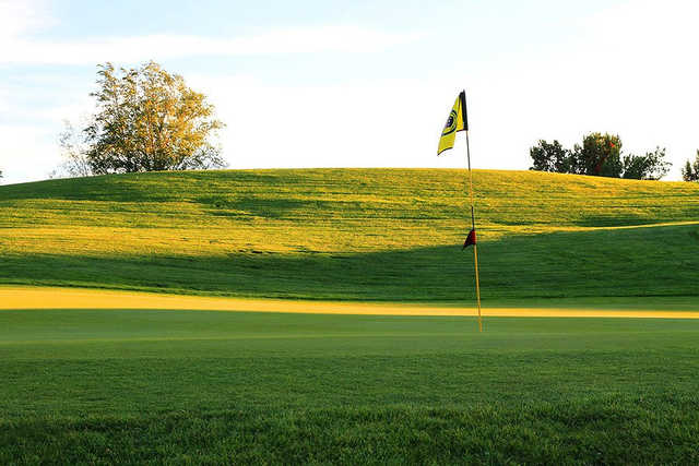 A sunny day view of the 17th hole at Cochiti Golf Club