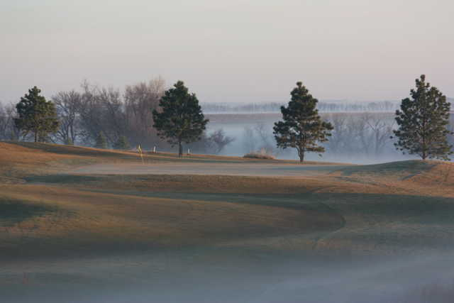 A foggy view of a hole at Lake Region Golf Course