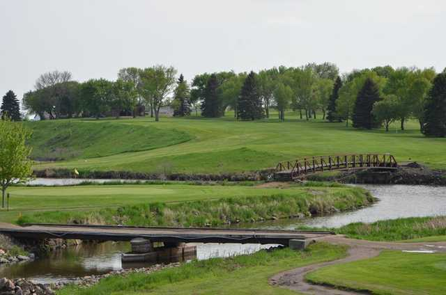 A view of a hole surrounded by water at Madison Golf & Country Club