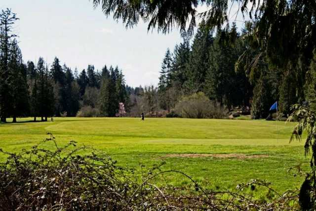 A sunny day view of a green at Cedars on Salmon Creek