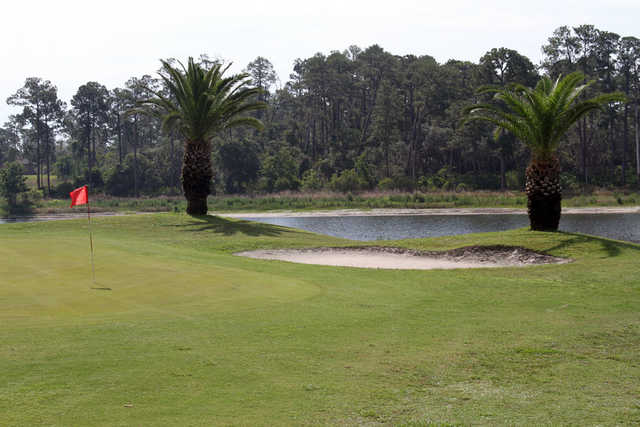 A view of a hole protected by a bunker at Glen Abbey Golf Club (SportsVolusia)