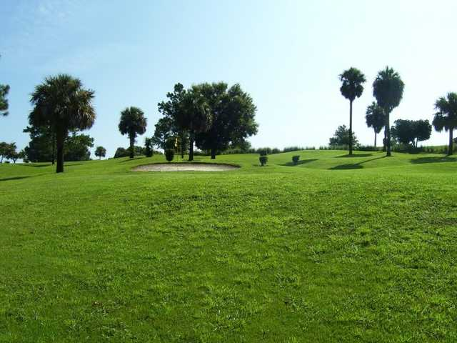 A view of a green protected by a sand trap at Fisherman's Cove Golf & Marina