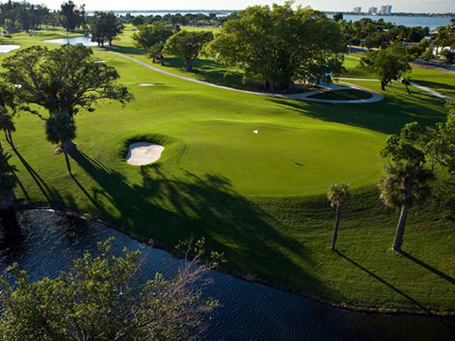 A view of a green with water coming into play at Normandy Shores Golf Course