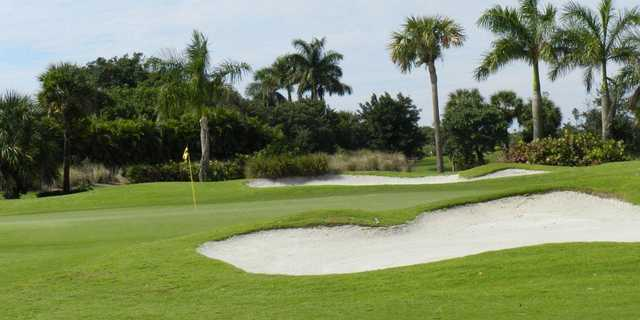 A view of a green guarded by tricky bunkers at Plantation Preserve Golf Course