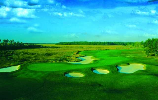 A view of a green protected by tricky bunkers from The Club at Osprey Cove Golf Club