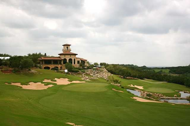 The 18th hole of the Westin La Cantera's Palmer Course features a dramatic shot downhill to the green protected by water.