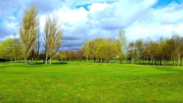 A view of a hole at Withington Golf Club