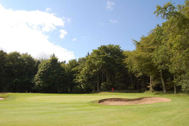 A view of a green flanked by bunkers at McDonald Golf Club