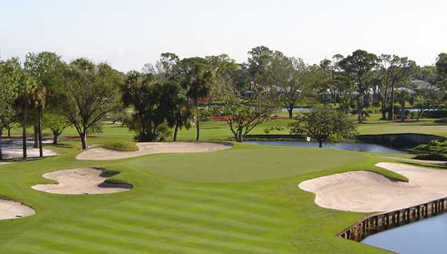 A view of a green protected by bunkers at Turtle Creek Club