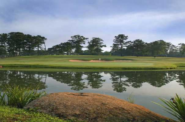 A view over the water of a hole at Canongate Golf Club