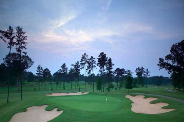 A view of a hole surrounded by bunkers at Canongate Golf Club