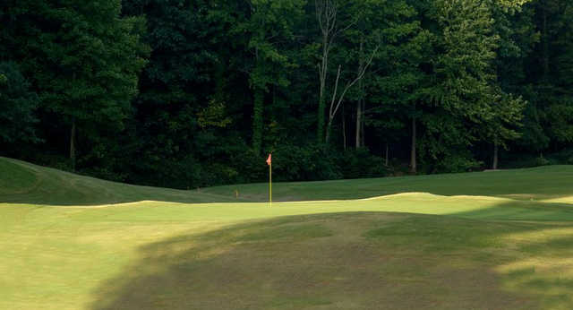 A sunny day view of a green at Indian Hills Country Club