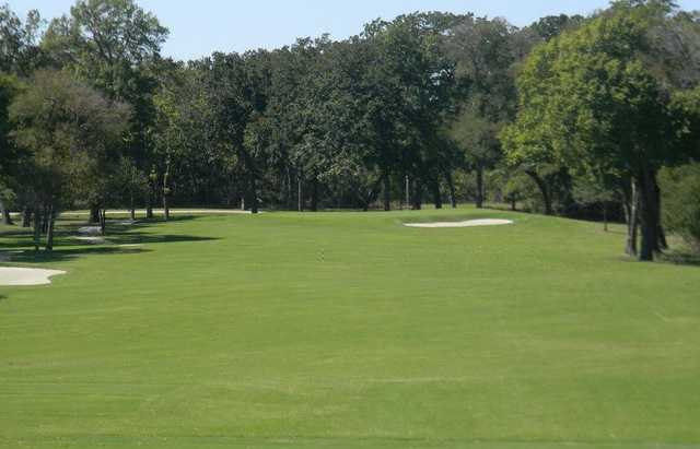 A view of a fairway at Pecan Hollow Golf Course