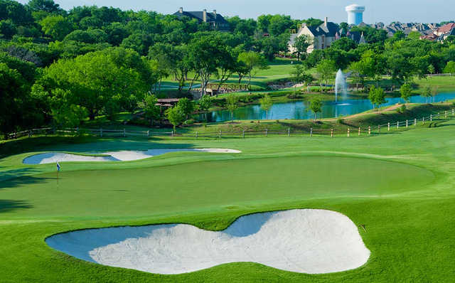 A view of a green protected by sand traps from Lakes at Castle Hills