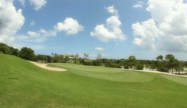 A view of a green protected by bunkers at Jupiter Hills Club