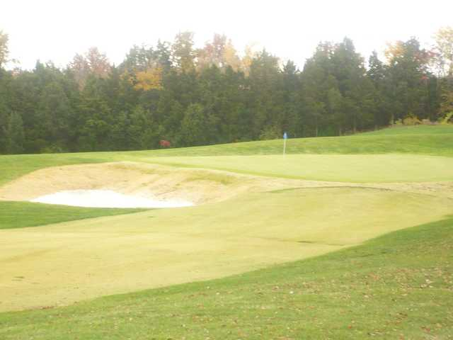 A view of a hole protected by a bunker at Bear Creek Golf Club