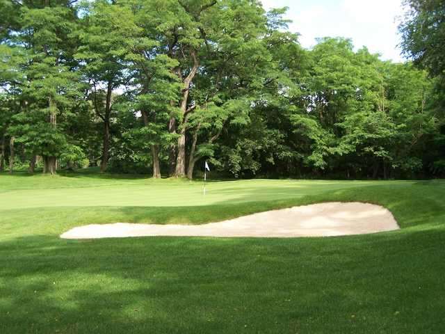 A view of a hole protected by a bunker at Mosholu Golf Course