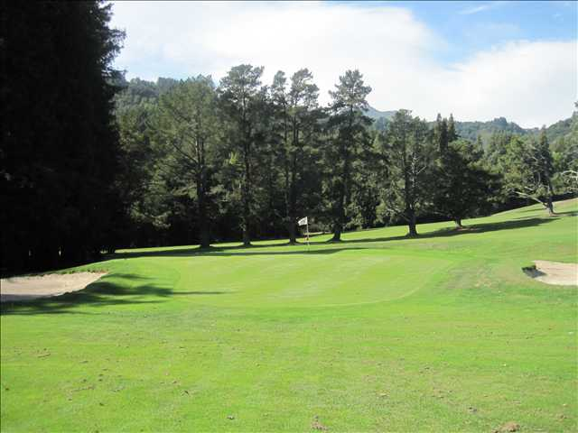 A view of the 5th hole flanked by sand traps at Mill Valley Golf Course