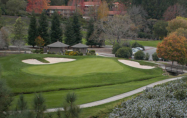A view of a hole protected by tricky sand traps at Rossmoor Golf Club