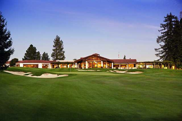 A view of a hole surrounded by sand traps at Los Altos Golf & Country Club
