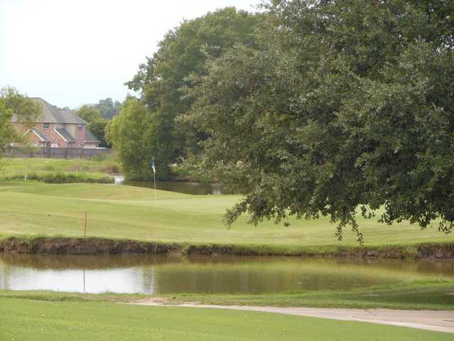 A view over the water of the 9th hole at Belle Terre Country Club