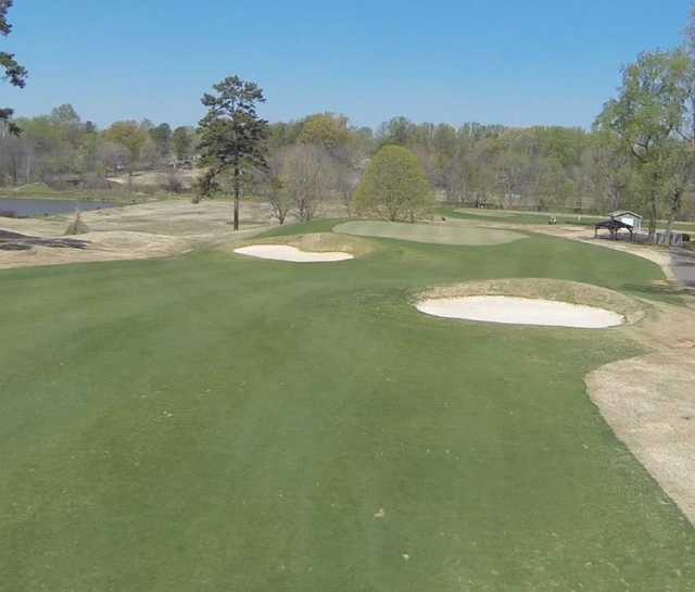 A view of a green protected by bunkers at Dr. Charles L. Sifford Golf Course from Revolution Park